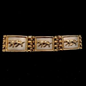 Silver and gold tone panel bracelet with big cats